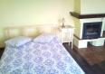 Apartament z kominkiem i pianinem